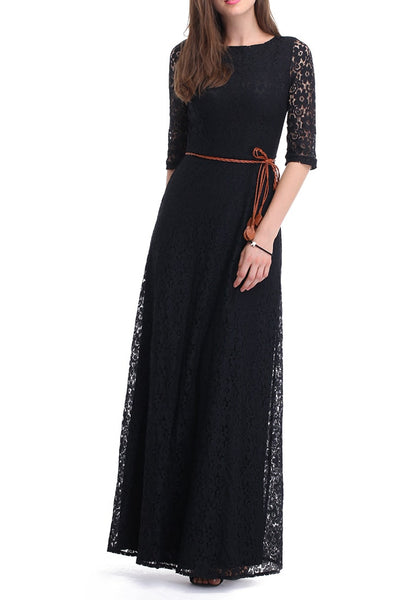 A brunette woman in a black maxi lace dress