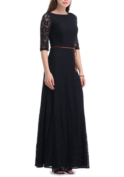 An angled left side view of woman in black maxi lace dress