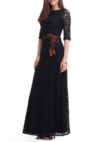 An angled view of a brunette woman in a black maxi lace dress