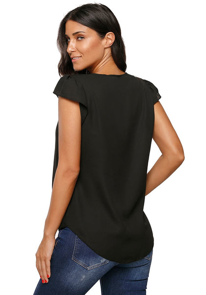 Angeled back view of model wearing black cap sleeves V-neck buttons tie-front blouse