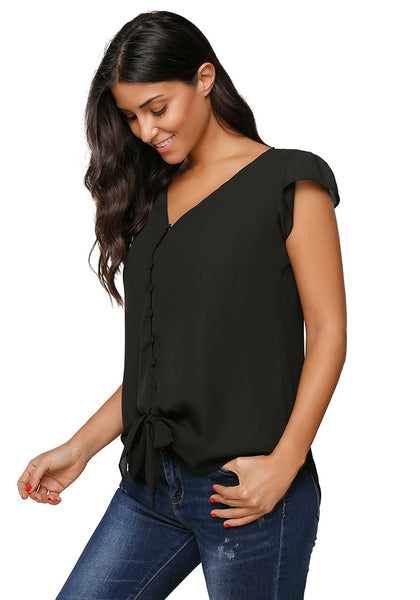 Angeled shot of model in black cap sleeves V-neck buttons tie-front blouse