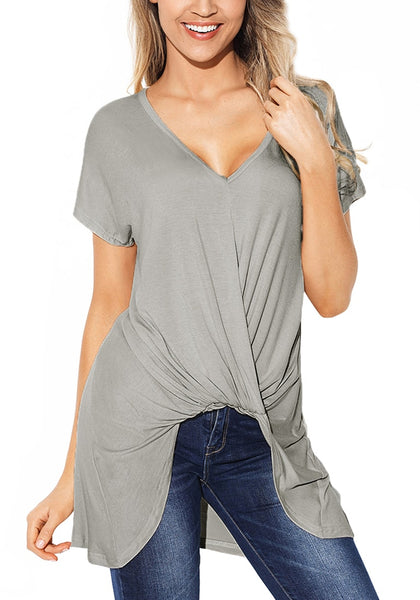Angeled shot of model in grey twist-front high-low blouse