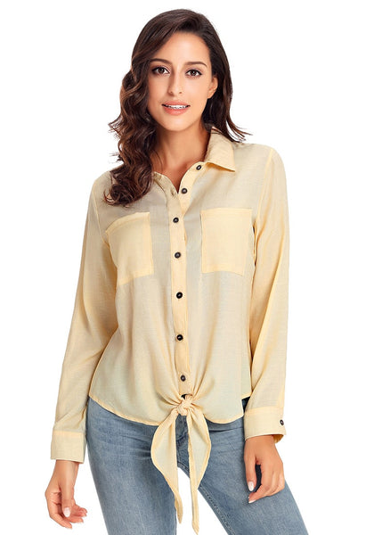 Angeled shot of model wearing beige 34 sleeves tie-front button-up blouse