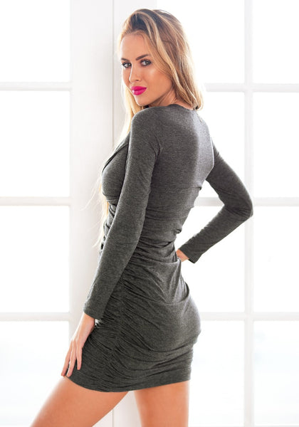 Angled back of  model in grey surplice ruched bodycon dress