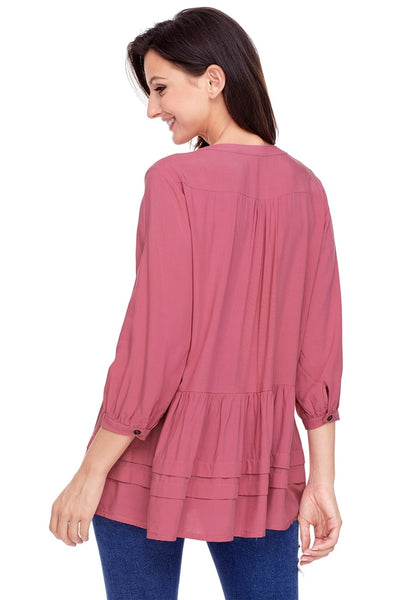 Angled back shot of model wearing deep blush button-front puffed sleeves tunic