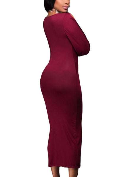 Angled back shot of woman in burgundy split sleeve ruched midi dress