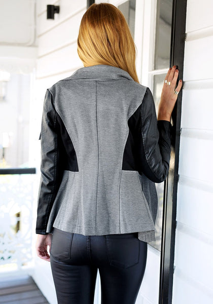 Angled back view of girl in grey PU-sleeve cowl neck jacket