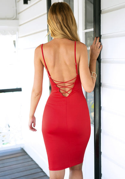 Angled back view of girl in red lace-up back bodycon dress
