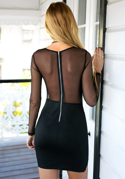 Angled back view of girl in semi-sheer bodycon dress