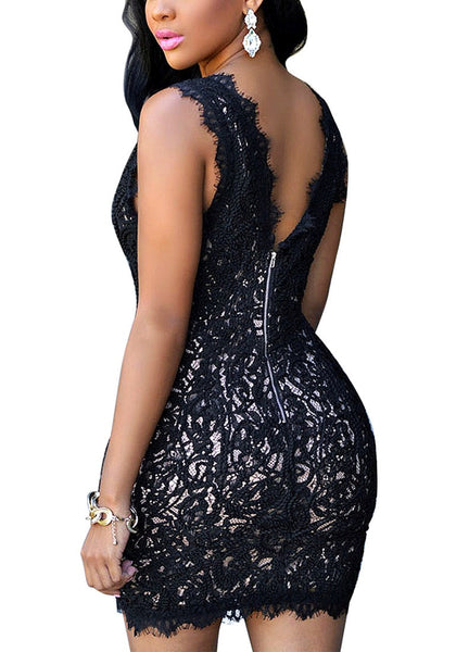 Angled back view of model in black lace plunge neck mini dress