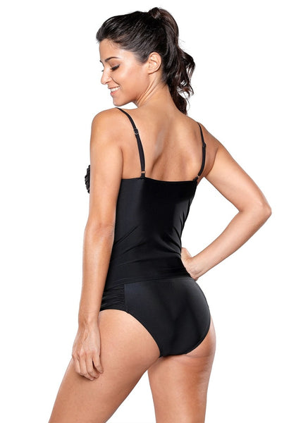 Angled back view of model in black ruched tankini set