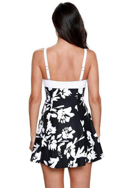 Angled back view of model in floral one-piece skater swimsuit