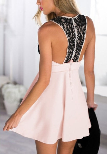 Angled back view of model in light pink plunge skater dress