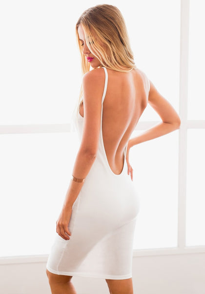 Angled back view of model in white ribbed cami bodycon dress