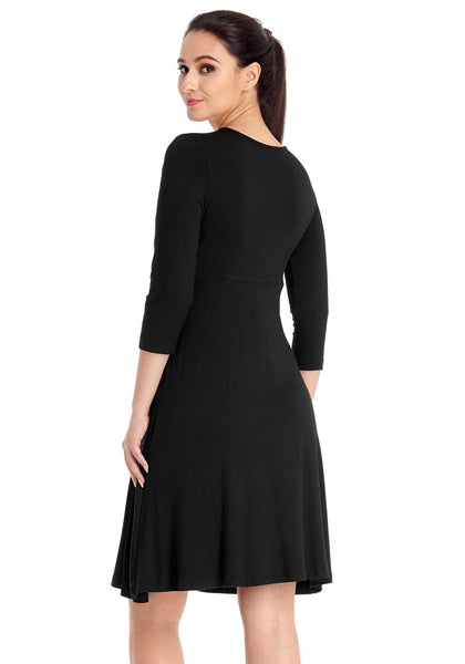 Angled back view of model wearing black V neckline ruched surplice maternity dress