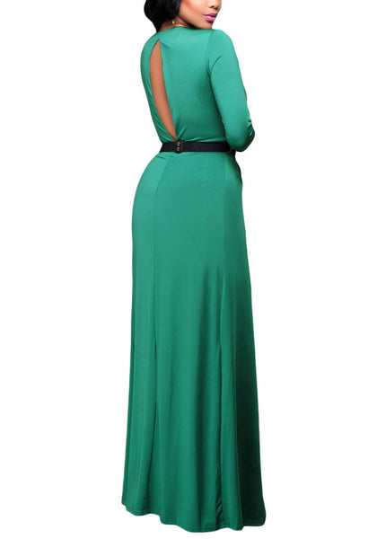 Angled back view of model wearing green wrap plunge-neck belted romper dress
