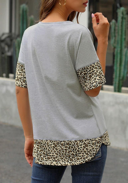 Angled back view of model wearing grey leopard patchwork half sleeves loose top
