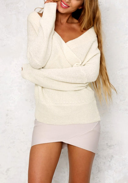 Angled front shot of pretty model in white wrap off-shoulder sweater