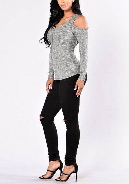 Angled full body shot of model wearing grey cold shoulder zip-front top