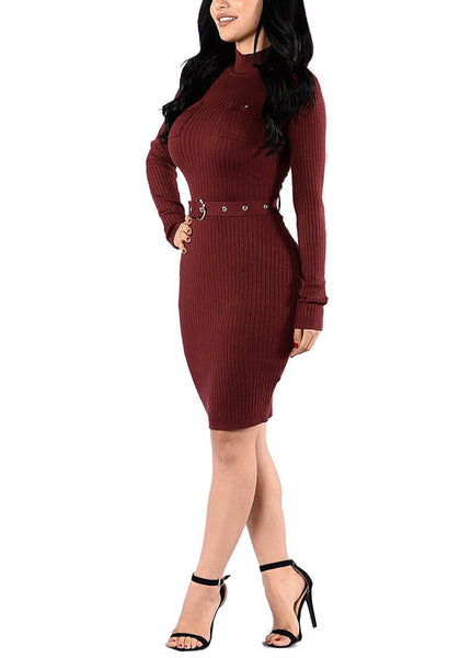 Angled full body shot of model wearing maroon mock neck belted ribbed midi dress