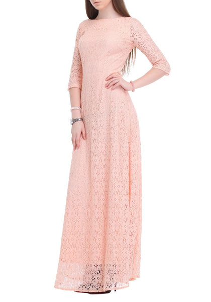 Angled right side view of brunette in pink maxi lace dress