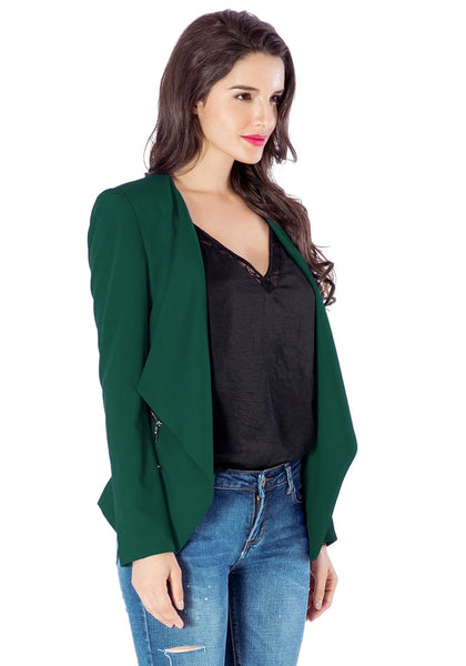 Angled right side view of model in deep green draped blazer