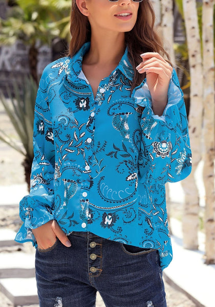 Angled shot of blue V-neckline boho floral-print button-up loose top