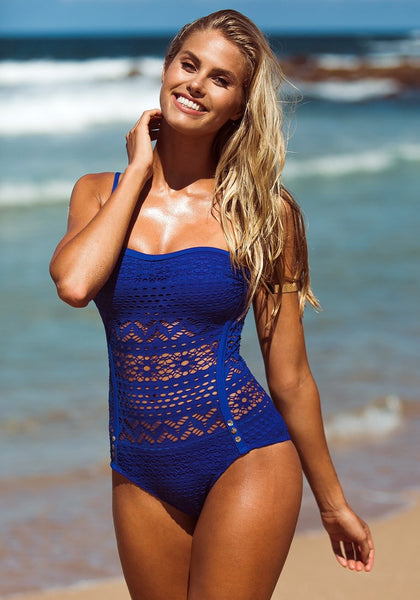 Angled shot of girl in blue lace halter swimsuit