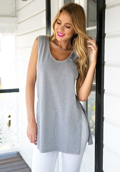 Front shot of girl in grey side-slit sleeveless tunic