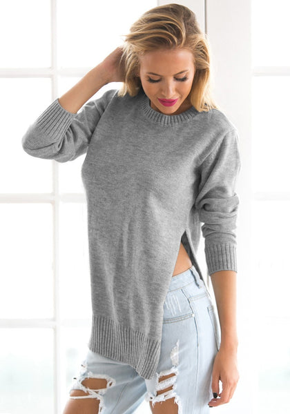 Angled shot of girl in grey side slit tunic sweater
