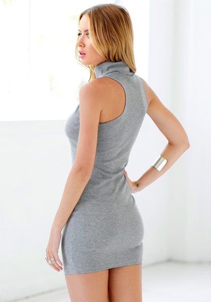 Angled shot of girl in grey sleeveless turtleneck dress