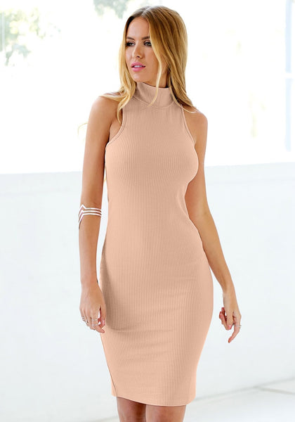 Angled shot of girl in mock neck bodycon midi dress