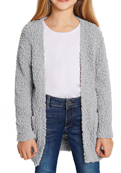 Angled shot of little girl in grey fuzzy fleece open-front girls cardigan