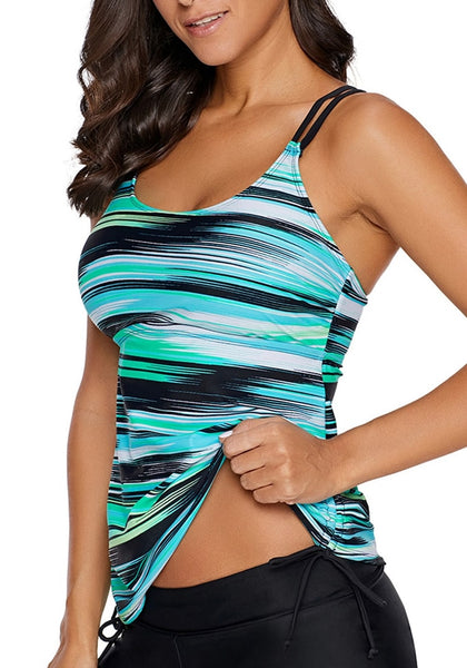 Angled shot of model in aqua abstract stripe-print strappy tankini top