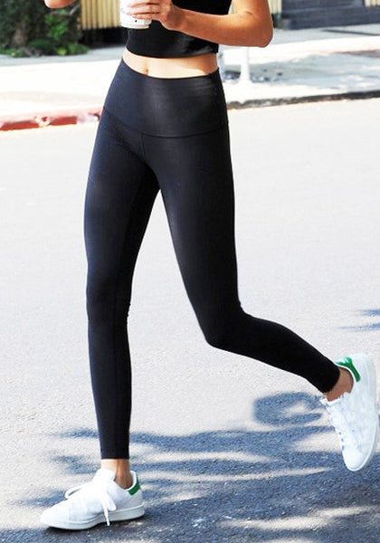 Angled shot of model in black high-waist leggings