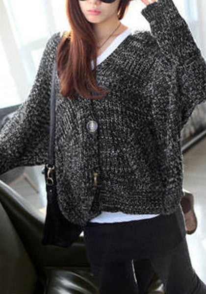Angled shot of model in black melange front-button cardigan