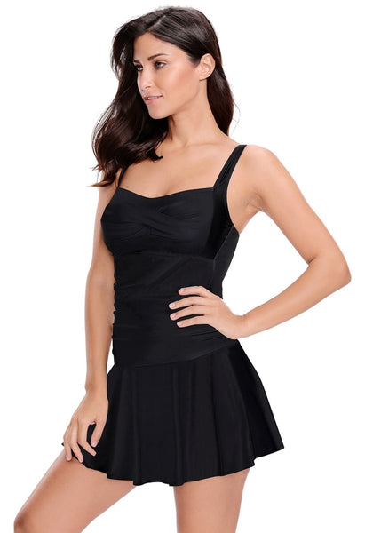 Angled shot of model in black ruched pleated swim dress