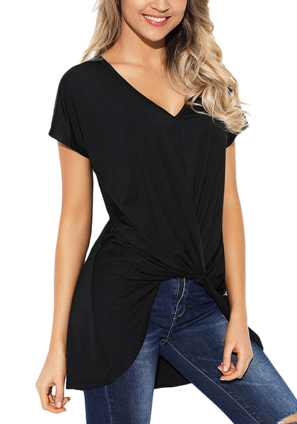 Angled shot of model in black twist-front high-low blouse
