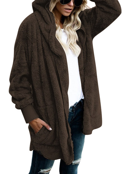 Angled shot of model in coffee snuggle fleece oversized hooded cardigan