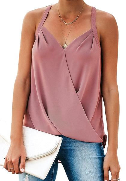 Angled shot of model in deep blush sweetheart neckline loose surplice cami top