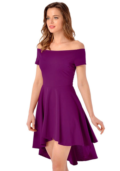 Angled shot of model in deep orchid off-shoulder high-low skater dress