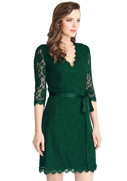 Angled shot of model in green lace overlay plunge wrap-style dress