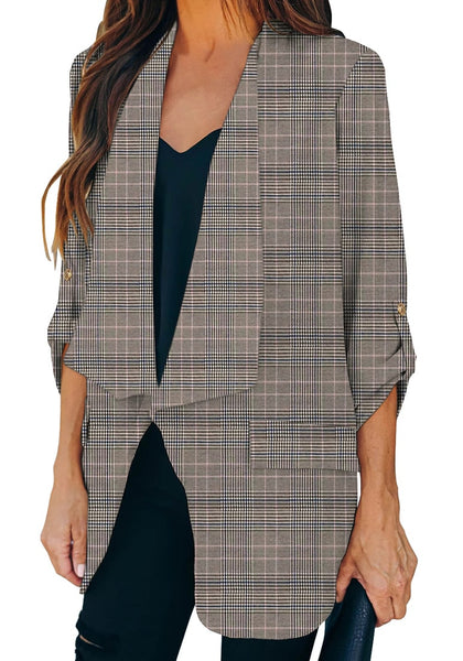 Angled shot of model in grey cuffed sleeves open-front draped plaid blazer