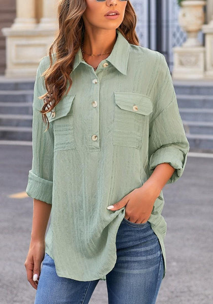 Angled shot of model in light green long sleeves half button-up tunic shirt