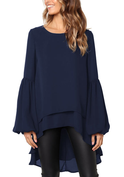 Angled shot of model in navy long lantern sleeves layered high-low blouse