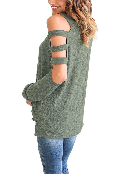 Angled shot of model in olive green cold-shoulder hollow-out blouse