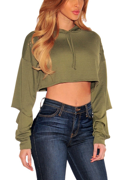 Angled shot of model in olive green ripped hoodie crop top