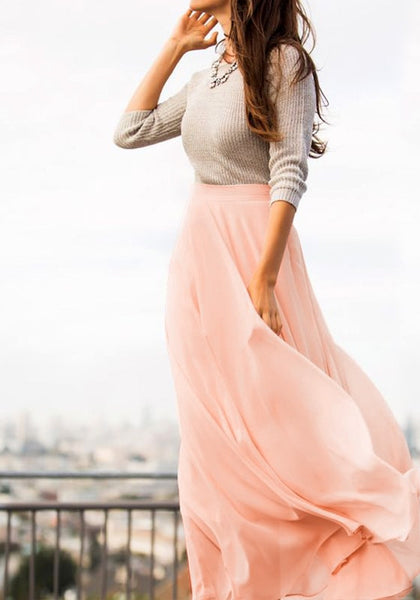 Angled shot of model in pink chiffon maxi skirt