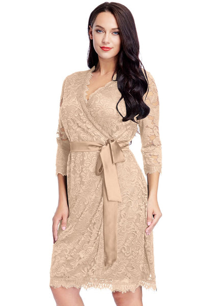 Angled shot of model in plus size beige lace crop sleeves wrap dress