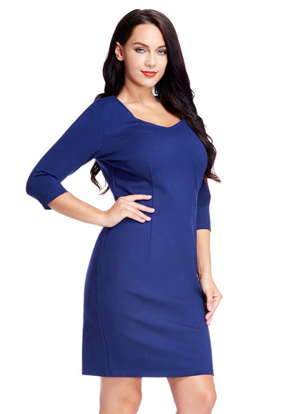 Angled shot of model in plus size blue decollete neckline pencil dress